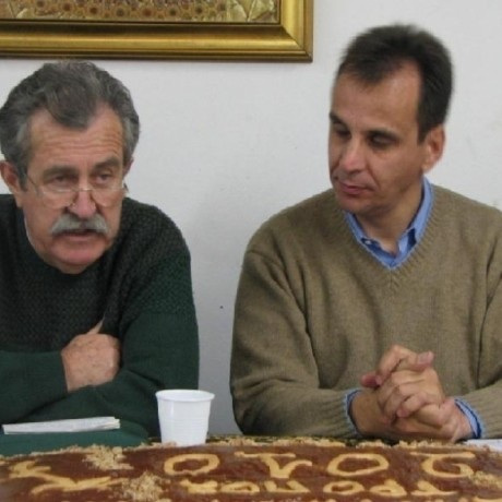 K. ANGELIDIS WITH THE PROFESSOR Mr. K. GEORGIOU AT THE EVENT OF NEW YEAR'S PIE CUTTING OF THE CHOIR IN 2010